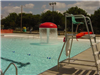 East end of pool with lifeguard stand and water spraying mushroom feature