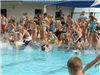 Kids rushing into the pool during the Clearwater Aquatic Center games