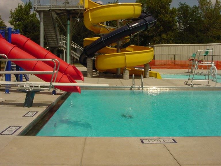 Looking across the deep end at the diving board and slides