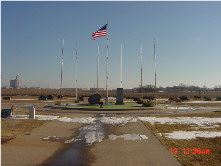 An American flag flying in the cemetery's memorial area.